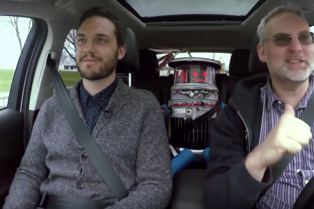 Tom Everett, Hitchbot and Dave Schellenberg in a car