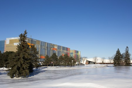 The exterior of the new Collections Conservation Centre, set against a snowy landscape.