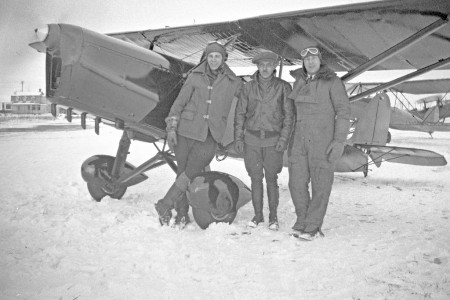 Three pilots posing with a Curtiss JN-4D Jenny aircraft at Cartierville