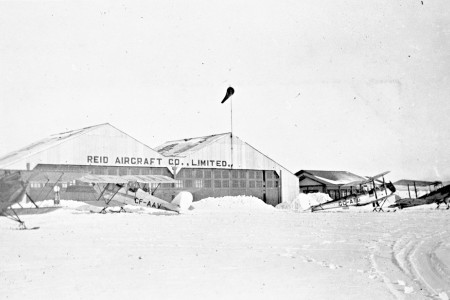 Reid Hangar at Cartierville Airport with aircraft in snowy foreground