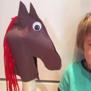 Young boy with his stick horse craft