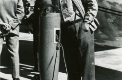 Hans Lundberg examining the magnetometer towed by a Beech Model 18 operated by the U.S. Geological Survey, Rockcliffe, Ontario, 12 September 1946. CASM, Spartan Air Services coll., negative no 35818.