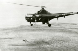 A Sikorsky HO3S of the U.S. Navy conducting a rescue exercise with a dummy aviator. CASM, negative number 32049.