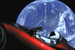 The Tesla Roadster floating through space. Earth in the background.