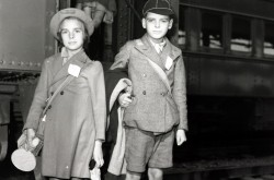 Two young evacuee children from Great Britain, standing at Bonaventure Station, Montreal, Quebec. August 1941.