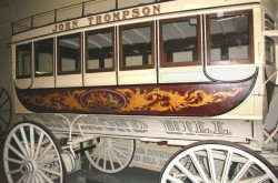A nineteenth-century coach decorated with gold leaf and the Royal Coat of Arms