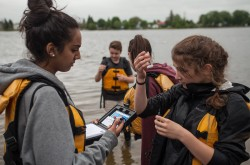 A group of young citizen scientists test water quality.