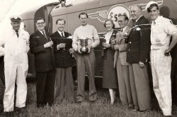 Pat Fillingham holding The Kings Cup with Sonja at his side. 1953