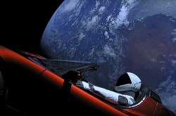 A mannequin sits in a red sports car, with the Earth in the background.