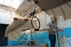 Dr. Andrea Bernardoni assembles a model for a flying machine, based on an engineering concept from Leonardo da Vinci.