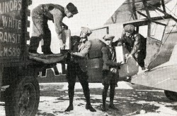"The unloading of the nitroglycerin carried from Shelby, Montana, to Calgary, Alberta, aboard the (purple?) Stinson SB-1 Detroiter operated by Great Western Airways Limited, February 1929. Anon., ""–."" Canadian Aviation, April 1929, 17."