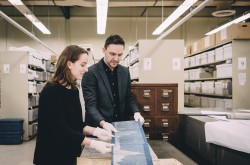 "Cristina Wood and Tom Everrett examine records of tailwater elevations from the Domtar/E.B. Eddy/J.R. Booth Collection, which provided some of the historical data sets used in the ""Songs of the Ottawa"" project."