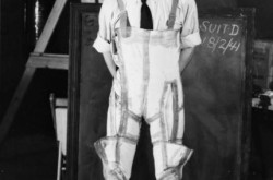 Wilbur Franks trying on his G-suit, 1941: Library and Archives Canada PA-063923