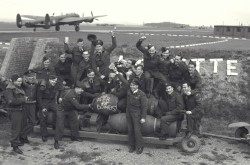 Members of No. 425 Squadron (Alouette) celebrating Victory in Europe Day, Tholthorpe, England, May 1945. Library and Archives Canada, PL-43999.