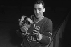 Montreal Canadiens Jacques Plante showing off his goalie mask, the Louch Shield, during practice. Library and Archives Canada/Montreal Star fonds/e011161492