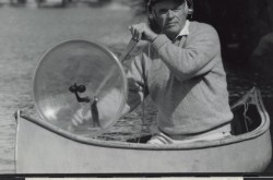 Dan Gibson in a canoe recording in Algonquin Park, Canada, with his Stereo Parabolic Microphone. Source: Library and Archives Canada/e011163804