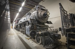 View of the CP 1201 locomotive in a concrete storage facility.
