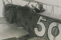 A black-and-white image of William George Barker in a German aircraft, which was allegedly captured in one of his last battles. Circa 1919