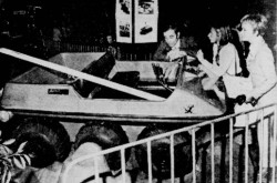 "Charles Aznavour with the Beehoo / Magna Amphicat all-terrain vehicle he was examining, Montréal, Québec. His daughter Seda is near him. Suzanne Piuze, ""Aznavour m'a dit…"" La Patrie, 25 January 1970, 20."