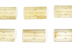 Six small rulers from a drafting kit are presented on a white background.