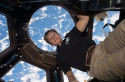 NASA Astronaut Peggy Whitson floating in the Cupola